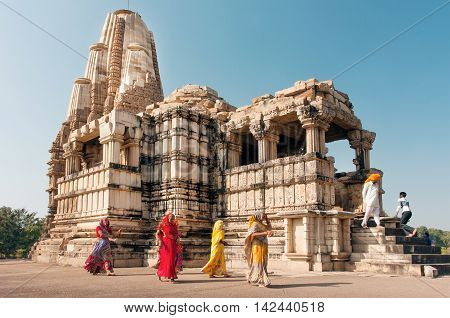 KHAJURAHO, INDIA - DEC 24, 2015: Women in indian sari dresses watching hindu temples on December 24, 2015 in Madhya Pradesh. UNESCO World Heritage Site Khajuraho Monuments built between 950 and 1150.