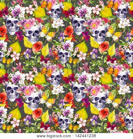 Human skulls with flowers and autumn leaves for Dia de Muertos holiday. Seamless pattern. Watercolor
