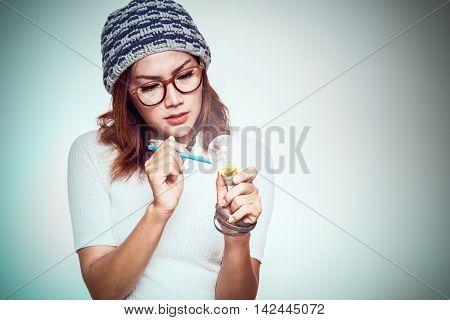 Asian woman with a light bulb idea emotionally.