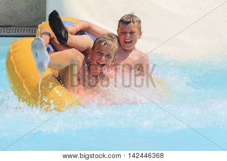 Rhodes Greece-August 1,2016:The group of boys on the rafting slide in the Water park.Rafting slide is one of many popular game for adults and children in park.Water Water Park is located on the island of Rhodes in Greece and one of the most largest in Eur