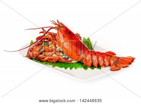 steamed lobster chinese luxury seafood on dish with banana leaf isolated on white background