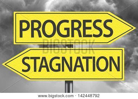 Progress x Stagnation yellow sign