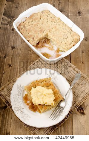 freshly baked rhubarb crumble with custard on a plate