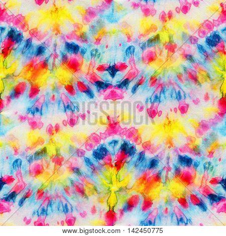 Multicolor seamless tie-dye pattern. Hand painting fabrics - nodular batik. Shibori dyeing.