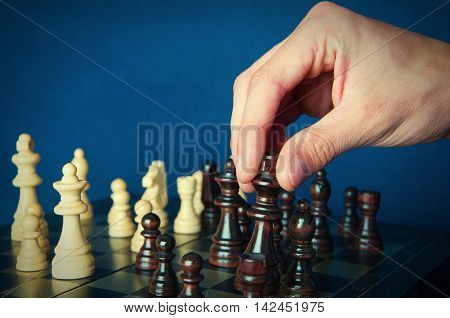An image of board chess and hand