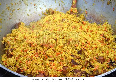 Large pot with Uzbek pilaf carrot and beef