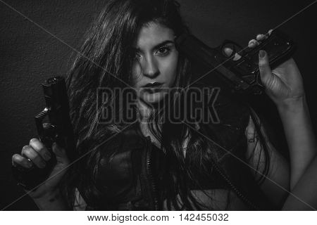 Police, brunette sensual and sexy with weapons in aggressive and dangerous position