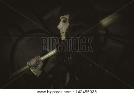 Effort, brunette sensual and sexy with weapons in aggressive and dangerous position