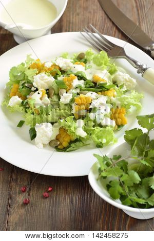 Salad with corn greens feta with mayonnaise sauce, vertical