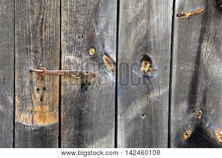 Old,weathered wood background with many knots throughout pretty grain texture.