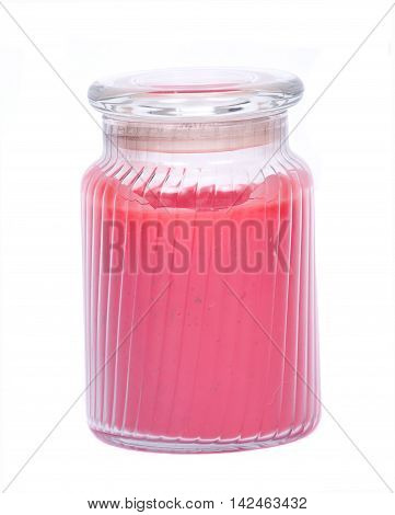 Red scented candle in jar separated on white background