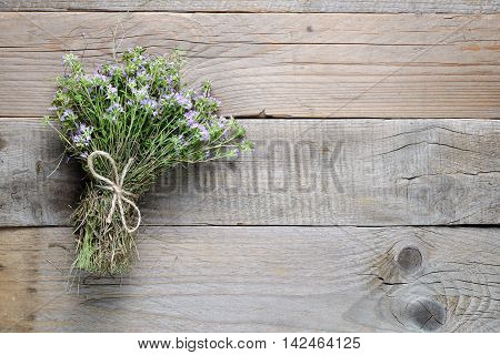 Bunch of thyme on old wooden background
