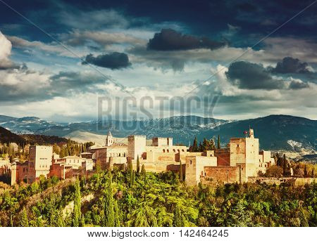 Fortress of Alhambra with stormy clouds. Granada, Spain