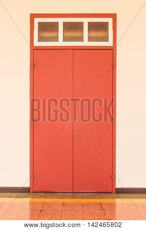 Old style wooden door in red color, Thailand