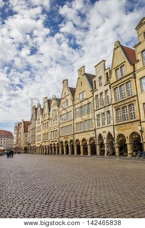 MUNSTER, GERMANY - AUGUST 7, 2016: Shops at the historical Prinzipal market square in Munster, Germany