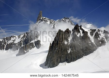 View of 4013 m peak Dent du Géant or Dente del Gigante and Glacier de Géant in the Mont Blanc Massif. Aosta Valley Italy