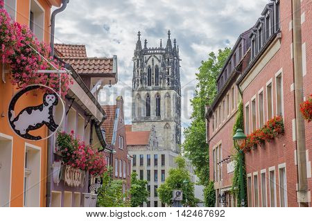 MUNSTER, GERMANY - AUGUST 7, 2016: Liebfrauenkirsche church and colorful street in Munster, Germany