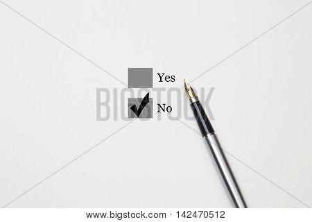 Tick placed in no checkbox, fountain pen