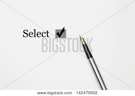 select box ticked and a pen on white background