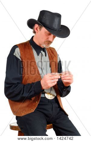 Attractive Cowboy Making Cigarette