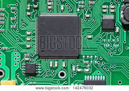 Close up a micro chip on an electronic board