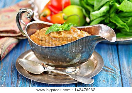 Eggplant dip with onions, carrots, tomato, olive oil, garlic and parsley.