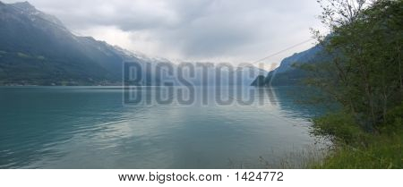 Lake Interlaken With The Alps Mountains In The Backgound, Switzerland, Panorama