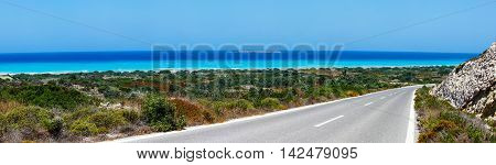Panoramic landscape with road near  Mediterranean sea. Rhodes, Greece.