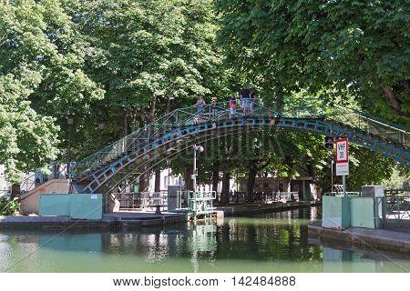 PARIS, FRANCE - AUGUST 9, 2016:pedestrian bridge over the Saint-Martin canal in Paris, France