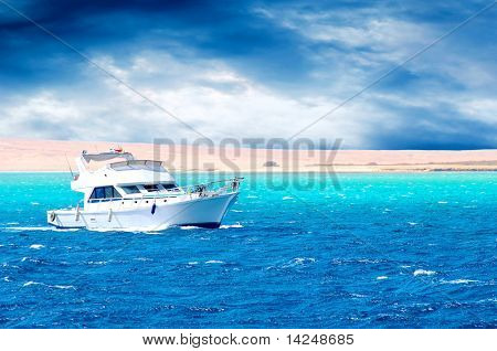 Side view of motor yacht under way out at sea