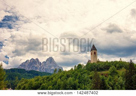 Landscape from the Dolomites with peaks and a church in south Tyrol Italy
