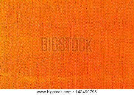 light vibrant orange woven plastic cloth texture