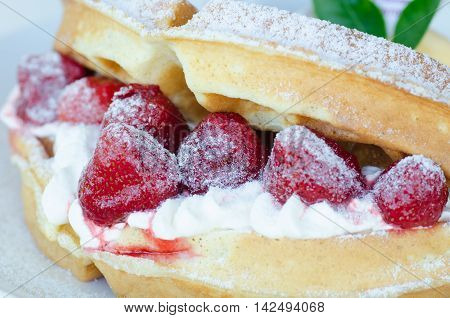 Strawberry waffle with ice cream on white plate