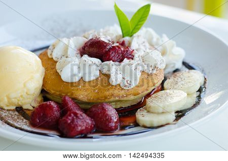 pancakes and ice cream on white plate