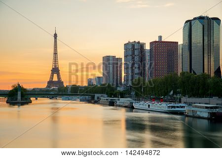 Eiffel tower and Paris skyline with skyscraper along Seine river in Paris France. Eiffel tower at morning in Paris France.