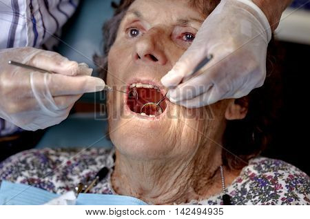Elderly Woman Gettng A Dental Check Up