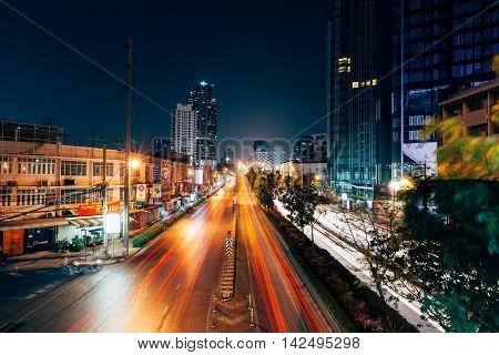 The Traffic Light Trails On The Street Of Bangkok