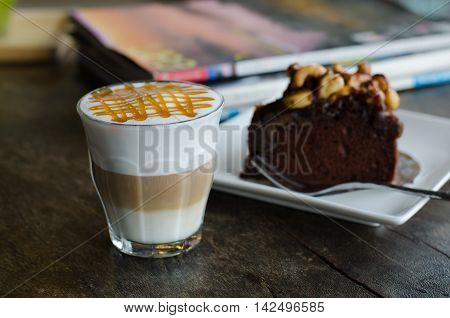 coffee macchiato and Toffee cake on wooden table