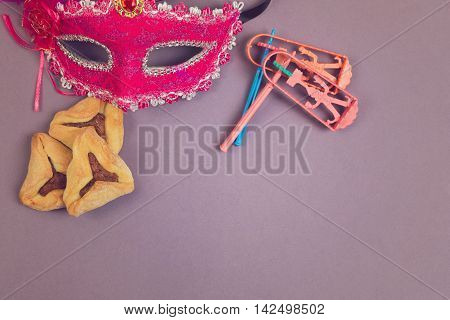 Traditional hamantaschen cookies grogger and carnival mask