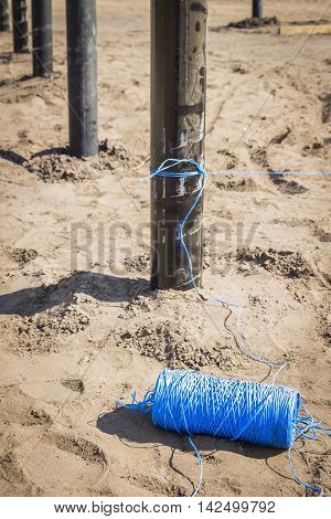 Hank construction blue rope lying on the ground at the construction site