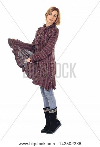Fashion model wearing burgundy sweater dress isolated