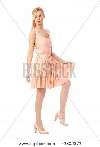 Fashion model wearing coral prom dress isolated