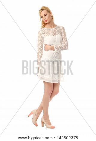 Fashion model wearing pink prom dress isolated