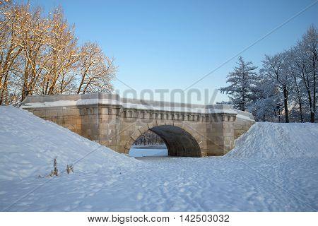 Vintage Karpin bridge of the Gatchina palace park on a january day. Russia