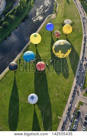VILNIUS LITHUANIA - AUGUST 11 2016: Hot air balloons in Vilnius city center on August 11 2016 in Vilnius Lithuania. Vilnius is one of few cities where hot air ballooning over the city is permitted.