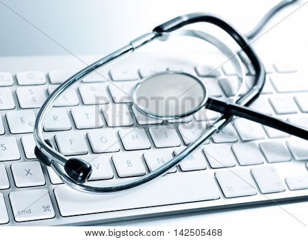 Selective focus of a computer keyboard and medical stethoscpoe. It-support.
