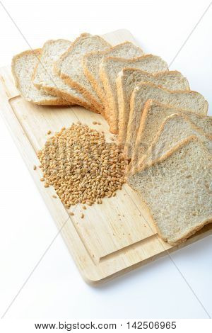 whole wheat bread and wheat grains on wooden tray