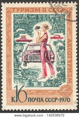 MOSCOW RUSSIA - CIRCA APRIL 2016: a post stamp printed in the USSR shows a woman and a car the series