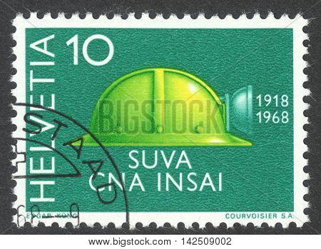 MOSCOW RUSSIA - CIRCA APRIL 2016: a post stamp printed in SWITZERLAND shows a helmet circa 1968
