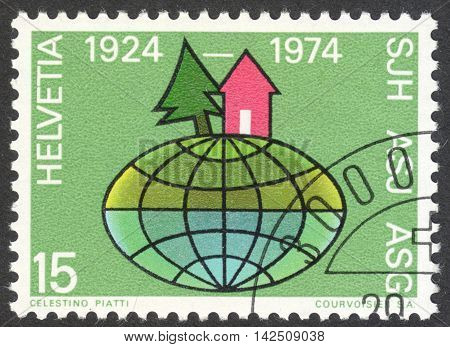 MOSCOW RUSSIA - CIRCA APRIL 2016: a post stamp printed in SWITZERLAND dedicated to the 50th Anniversary of Swiss Youth Hostels circa 1974